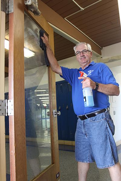 Mr. Marty Petitgout cleans the high school before the homecoming football game.