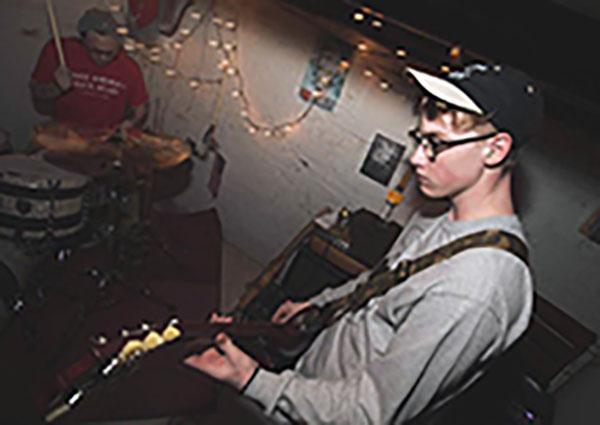 Scott plays his guitar at a show