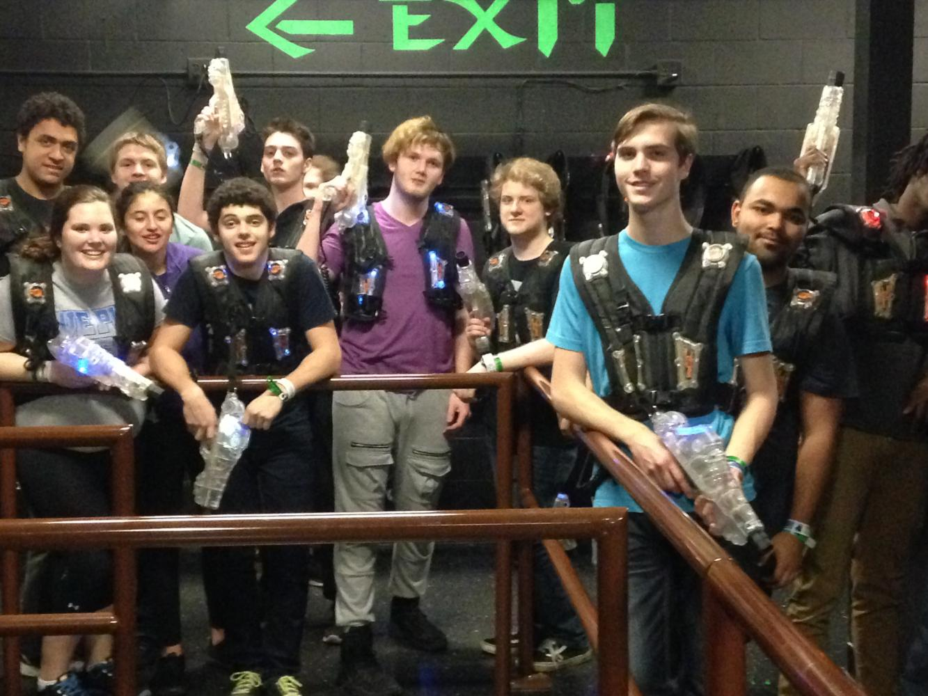 Members of the Senior Class reluctantly pose immediately after finishing a tiring round of Lazer Tag inside the Kalahari Resort.