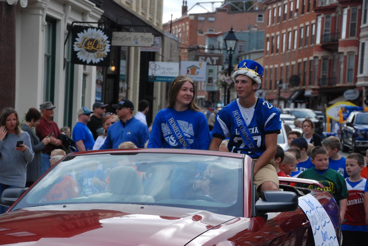 Homecoming king and queen, Samantha Stoffregen '19 and Conner Einsweiler '19, roll down the street during the homecoming parade.