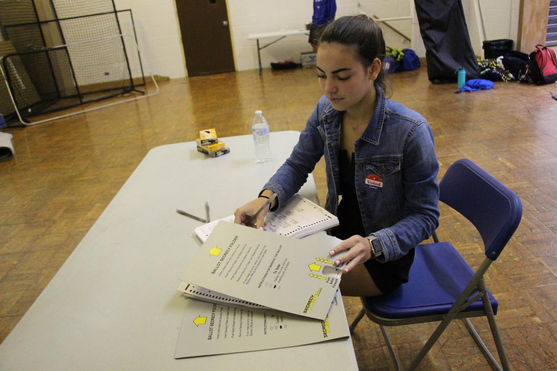 Senior Morgan Wills acts as a judge as she prepares the ballots.