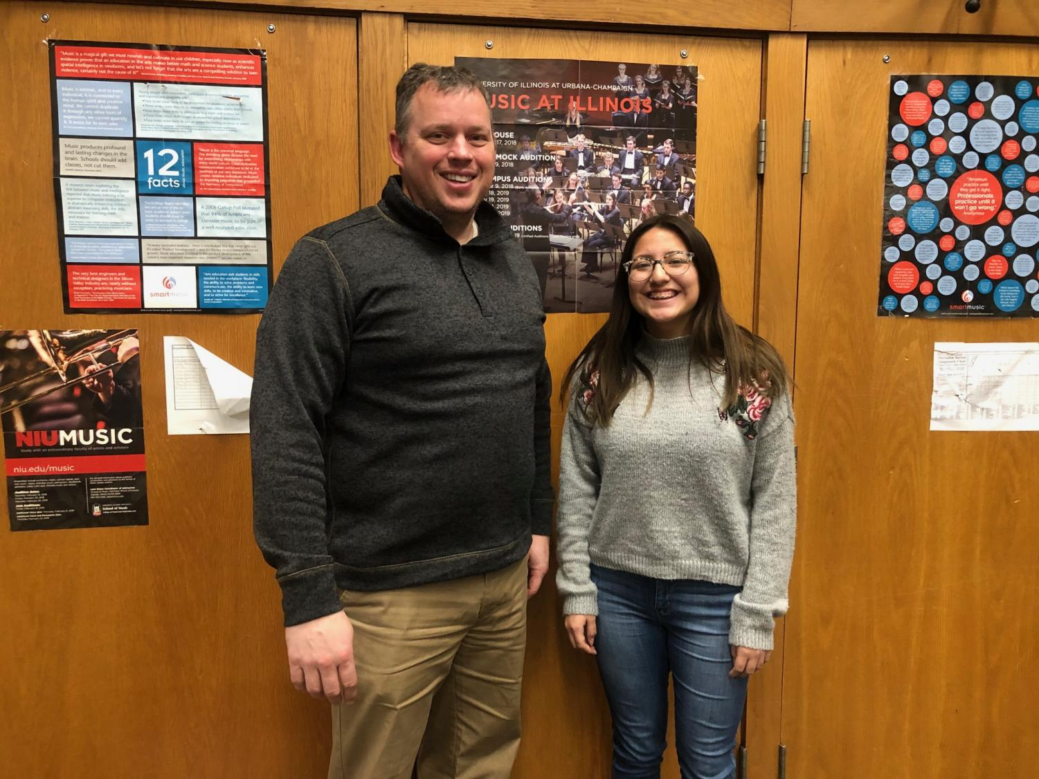 "Facing the fear of failing: Veronica Osorio '19 standing alongside with Mr. Holland in the band room. This is where Veronica had to make up 13 practices. ""I really had the mindset that I was going to fail this class. I really didn't want to go in and play the songs. Then I fell in love with two of the songs and that was all I played. Mr. Suau also had a huge part in helping me practice. I really appreciate them both."" said Osorio."