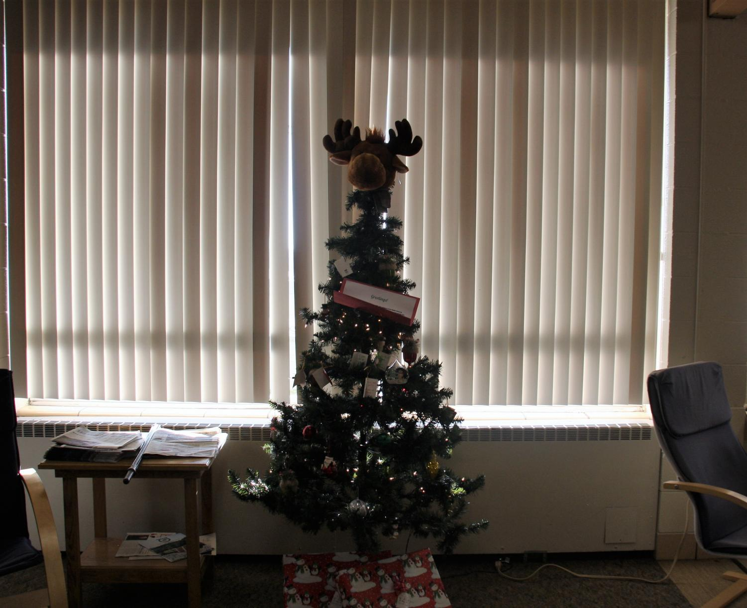 """Wood you like to give back? GHS has many chances for students to contribute before the semester ends. Pictured above is the NHS Giving Tree. There is also Elk dinner tickets available and raffle tickets for an Apple Watch on sale, which is all for a good cause. Abbey Ehrler '21 said, """"Giving back makes me feel so happy!"""