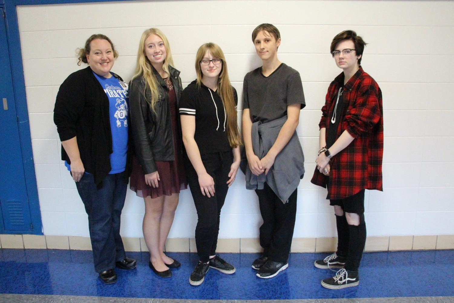 "Caption -- Speak out! Coach Susan Bookless smiles for the camera along with speech team members Sophia Getz, '20, Emilly Folks, '19, Robert Schuh, '19, and Judas Benson, '21. Benson and Schuh both placed in their first meet of the season on December 1. ""Speech team was a great choice for me because I love to talk and it helps me speak in a more well developed manner,"" said Schuh."