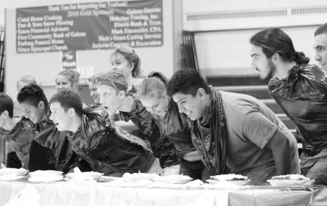 """Chow down. Jacinto Lopez Brito '22, Clay Folks '21, Trevor Hoell '21, Elizabeth McGruder, David Garcia '20, and Richard Kern '19 are ready to go. The students competed in the pie eating contest as part of Homecoming Week. """"It was a lot of fun,"""" said Trevor Hoell '21."""