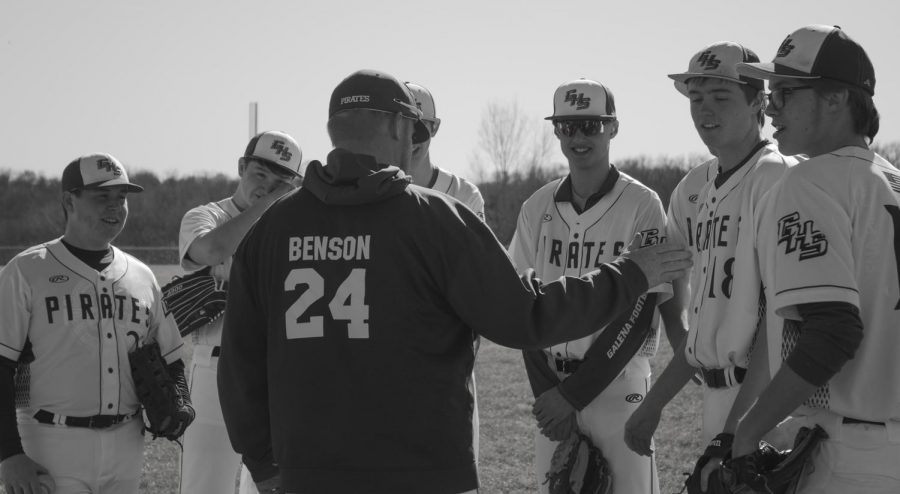 Coach+Benson+gives+advice+to+baseball+players+sophomore+Clay+Folks%2C+sophomore+Owen+Wells%2C+junior+Ben+Nack%2C+freshman+Brady+Schemehorn%2C+junior+Chance+Wills%2C+and+junior+Henry+Anderson+during+the+game+against+the+Pearl+City+Wolves.+The+team+came+out+on+top+with+a+score+of+3-2.+Evan+Kruse+was+a+notable+player+of+the+game+with+a+walk+off.+Both+the+coaches+and+the+players+are+excited+to+see+what+the+season+holds.
