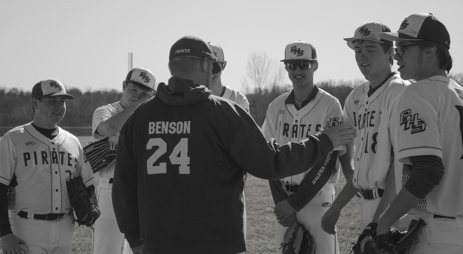 Coach Benson gives advice to baseball players sophomore Clay Folks, sophomore Owen Wells, junior Ben Nack, freshman Brady Schemehorn, junior Chance Wills, and junior Henry Anderson during the game against the Pearl City Wolves. The team came out on top with a score of 3-2. Evan Kruse was a notable player of the game with a walk off. Both the coaches and the players are excited to see what the season holds.