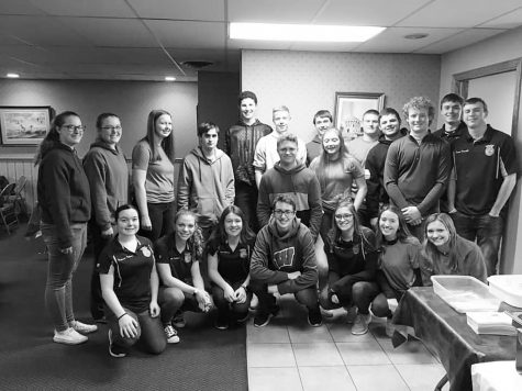 "Galena FFA alumni held their first annual fish fry, followed by the alumni auction. Pictured, Samantha Deinineger, Aly Anderson, Sadie Sedbrook, Sam Niedholdt, Jarrett Bastan, Nate Heuer, Dylan Shemehorn, Austin Meyer, Hunter Bastan, Kade Timmerman, Chance Wills, Connor Einsweiler, Mackenzie Furlong, Maggie Handfelt, Samantha Stoffregen, Chris Simmon, Kenzie Casper, Addison Soat, Sawyer Quick. FFA had a great success at the FFA fundraiser as they sold just under 400 tickets for the dinner that following the auction. Maggie Handfelt '21 said, "" I was happily surprised at how many people showed up to the fish fry. It really meant alot that so many people did show up and rally together for out chapter."""