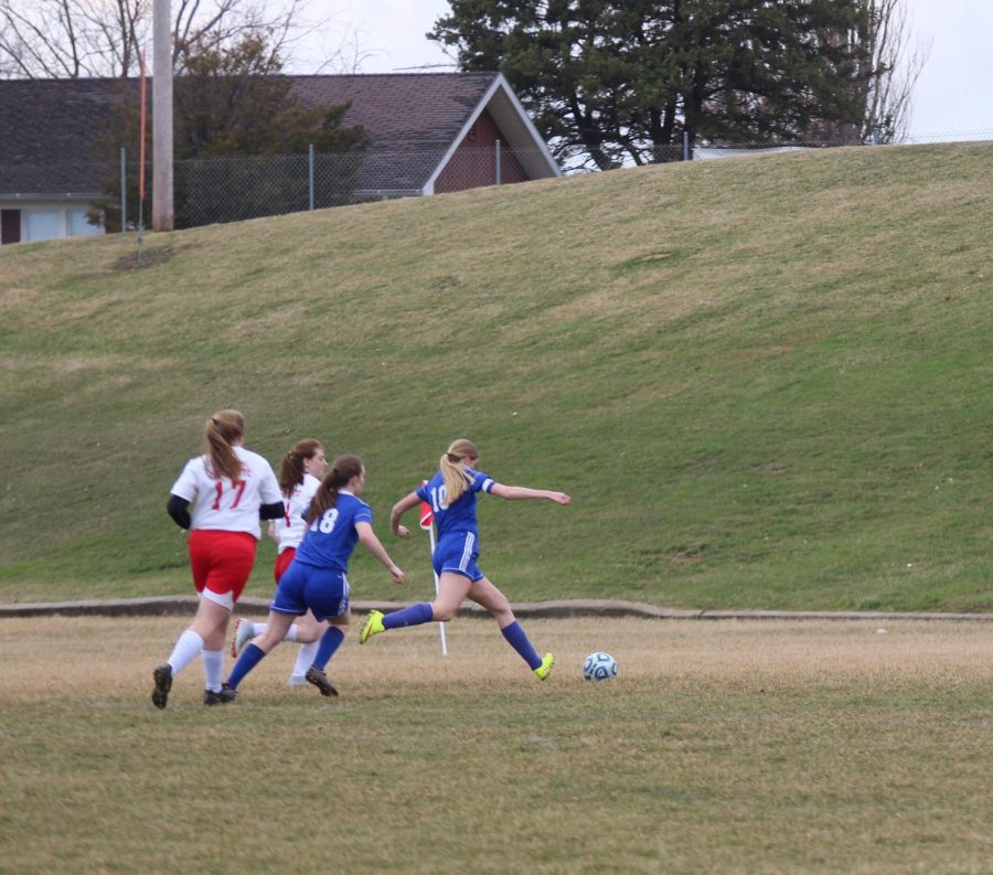 Team captain, Hanna Skiston, runs after the ball to protect their goal.