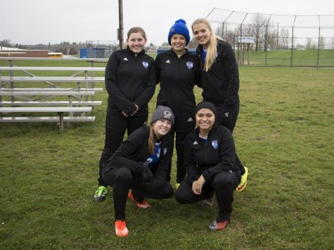 "Varsity and Jv girls soccer play their last home soccer game. Pictured, Kaitlin Rodriguez, Elena Garcia, Hanna Skiston, Shea Curran, Gema Luna. Senior girls played their last home soccer game against Richland Center on Tuesday April 30. Skiston '19 said, "" It was sad that we lost our last game that the seniors would ever play on our home field. It was also nice to see quite a few more fans there to support the team for our last game!"""