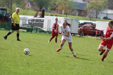 "Junior Mckenna Curran sprints to the ball heading towards the goal. Curran scored the only goal for the team against the Bellevue Marquette Eagles. ""It was a bummer we couldn't come out with a win, but we shouldn't let that get us down,"" said Curran. ""We've improved a lot this season, and I hope that shows as we go into our first round of regionals."""