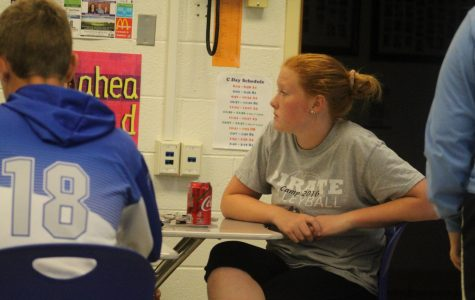 """Caption: Student Council member Gracelynn Lange '21 talking and discussing homecoming games. The student council ate pizza and talked about homecoming. """"It was great to have extra time to plan for homecoming,"""" said Gracelynn Lange '21."""