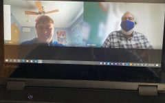 """Mr. Jenkins and Zack Ehrler smile for a picture over a Google Meet for the """"Thank You Tuesday"""" sponsored by the GHS Student Council. Ehrler is one of the GHS students who is learning from home this year."""
