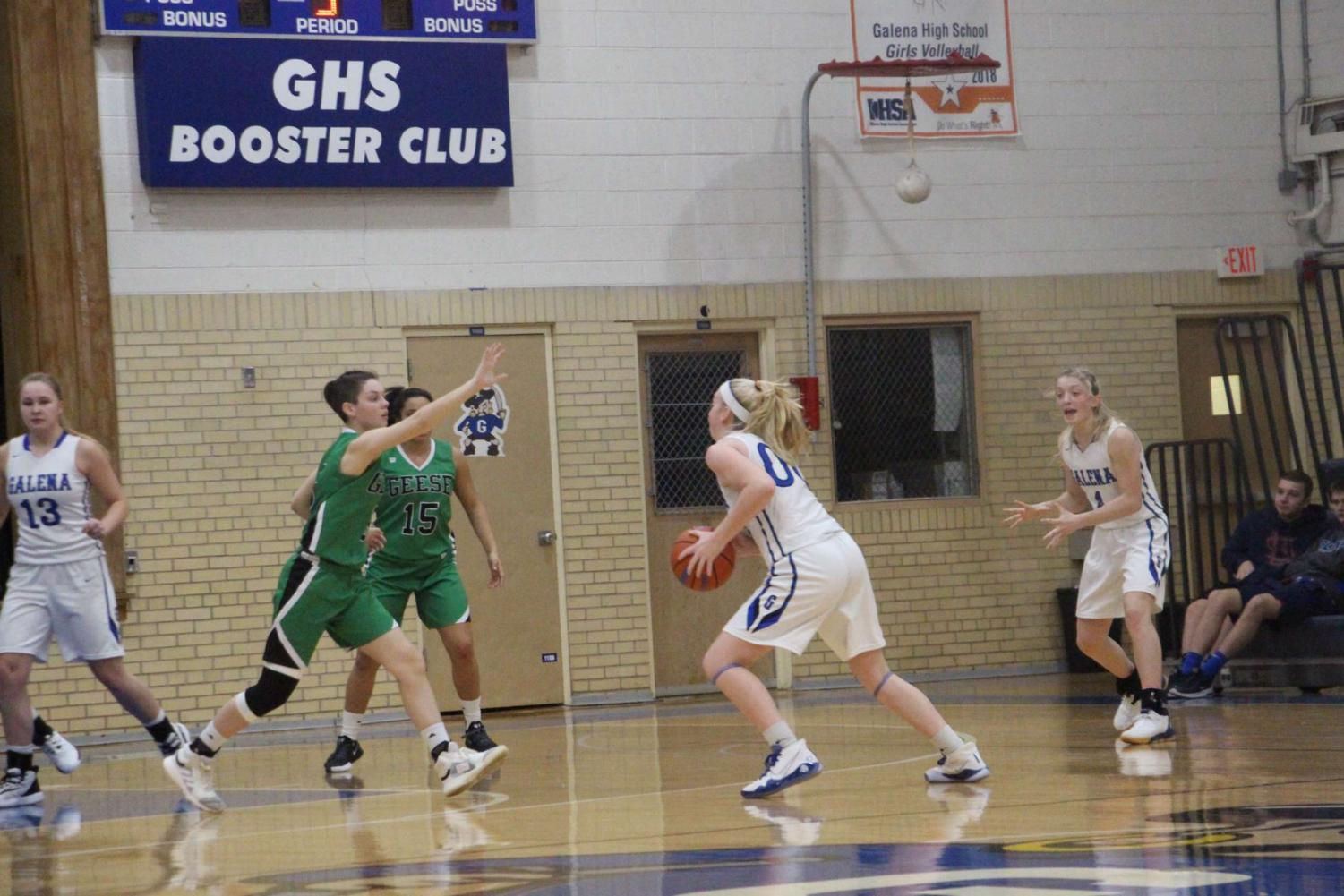 """Striding for greatness. Corrina Noble '21 drives a ball down the court in a past 2019 game against Wethersfield High School. """"I am really excited to see how this season goes. It's going to be a very different experience, but I am trying to look at it in the most positive way possible to ensure that this season will be fun and successful"""" , stated Noble."""