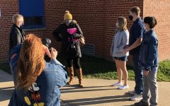 "Finding ways to stay safe, the Drama Club begins shooting scenes while remaining socially distanced. Pictured above (left to right), Mrs. Jenkins films Daniel Heid, Mrs. McIntyre, Maya Dickerson, Caleb Soat, and Jovian Pham. Mr. and Mrs. Jenkins have worked hard to make sure that the state the world is in won't take away the fall play. Mrs. McIntyre stated, ""I'm sure there will be many hiccups along the way, due to COVID, but they are organized so it will all come together at some point."" The Drama Club has adapted to the changes of the world extremely well and their latest production is sure to be another big hit!"