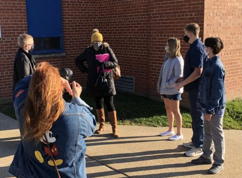 "Finding ways to stay safe, the Drama Club begins shooting scenes while remaining socially distanced. Pictured above (left to right), Mrs. Jenkins films Daniel Heid, Mrs. McIntyre, Maya Dickerson, Caleb Soat, and Jovian Pham. Mr. and Mrs. Jenkins have worked hard to make sure that the state the world is in won't take away the fall play. Mrs. McIntyre stated, ""I"