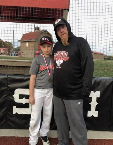 Coach Michael Benson with his son Jaycob Benson after a Sluggers Game.